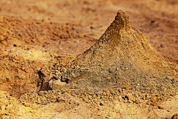 PhotoDune A pyramid of sand in the sandbox 4047985