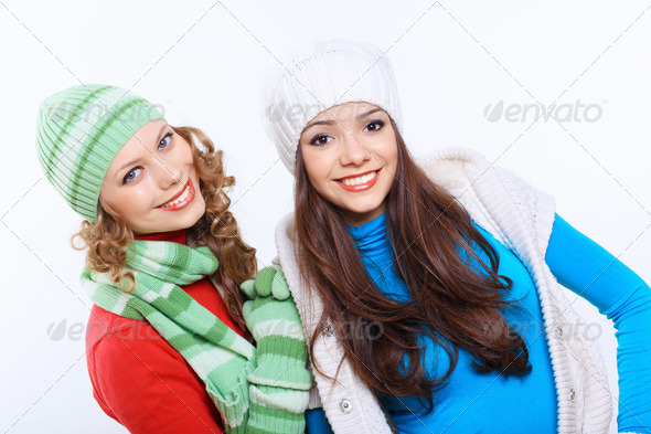 PhotoDune Young woman wearing winter hat and warm scarf 4048127