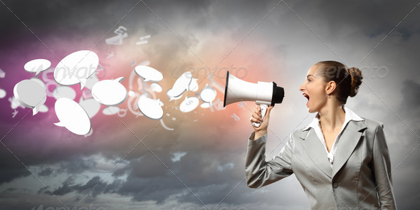 businesswoman with megaphone - Stock Photo - Images