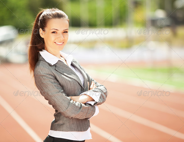 Business woman at athletic stadium - Stock Photo - Images