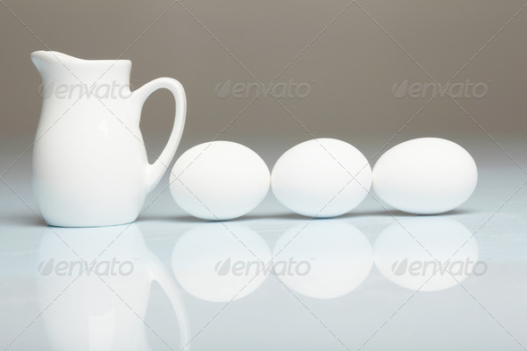 PhotoDune Milk in a glass jar and eggs 4048147