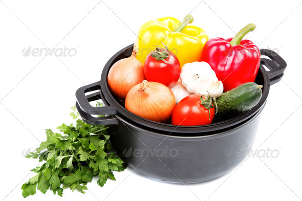PhotoDune Fresh vegetables in black saucepan on a white background 4049254
