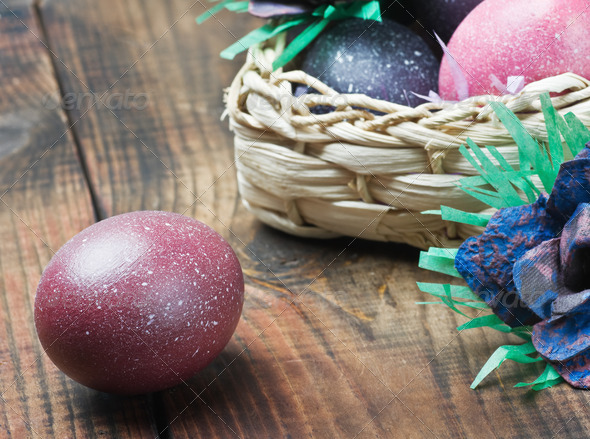 PhotoDune Colorful easter eggs in brown a basket 4081649