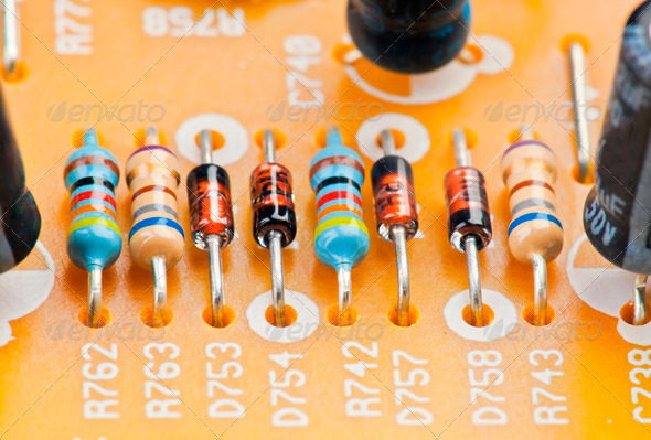 PhotoDune resistors and diodes mounted on motherboard with other components 4049419