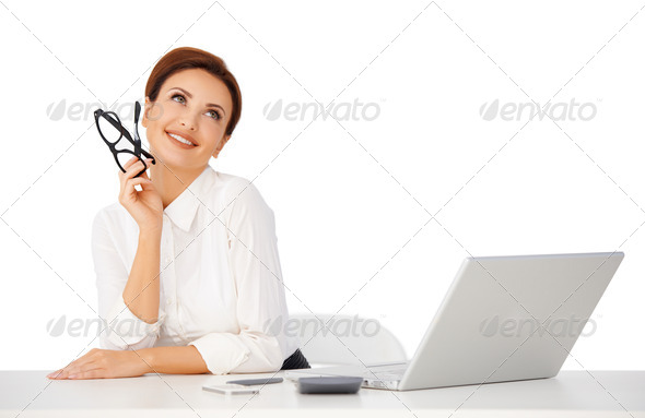 Beautiful businesswoman dayreaming - Stock Photo - Images