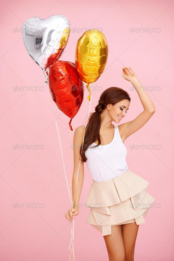 PhotoDune Dancing brunette with balloons 4061297