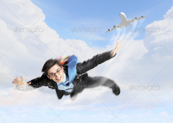 PhotoDune Young businessman flying with parachute on back 4061309