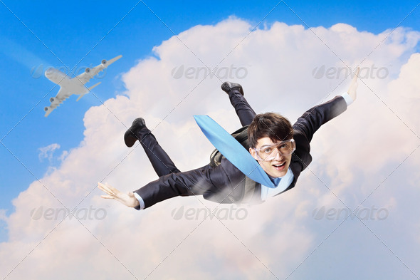 PhotoDune Young businessman flying with parachute on back 4061313