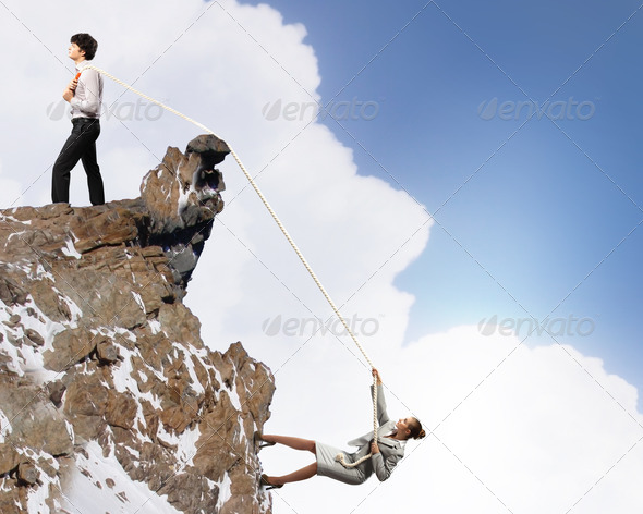 PhotoDune Two businessmen pulling rope atop of mountain 4061328