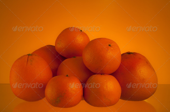 oranges over orange - Stock Photo - Images