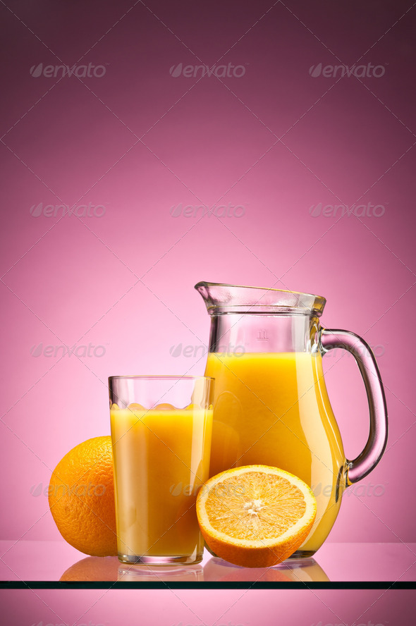Orange juice over pink - Stock Photo - Images