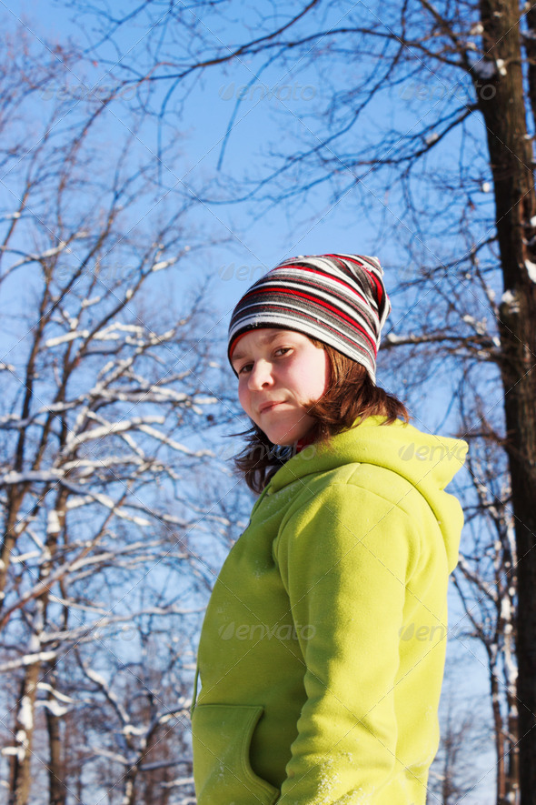 PhotoDune A teenage girl in the Park in the winter 4124621
