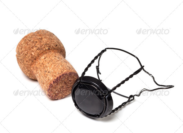 Champagne wine cork and black muselet - Stock Photo - Images