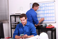 Two electricians working in back office
