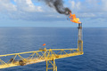 The gas flare is on the offshore oil rig platform.