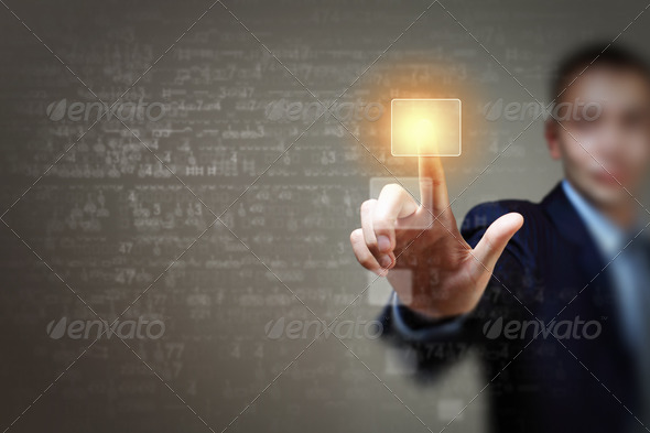 Business man touching display - Stock Photo - Images