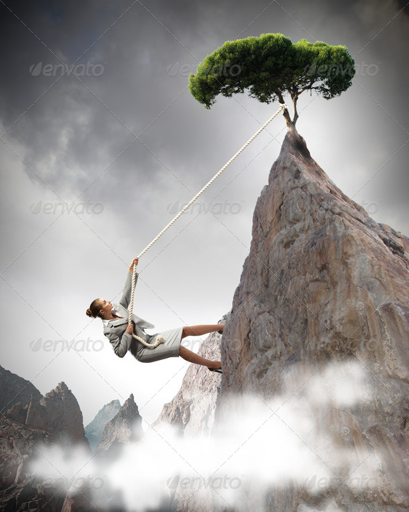 businesswoman climbing mountain - Stock Photo - Images