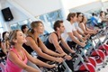 Gym people on spinning machines - PhotoDune Item for Sale