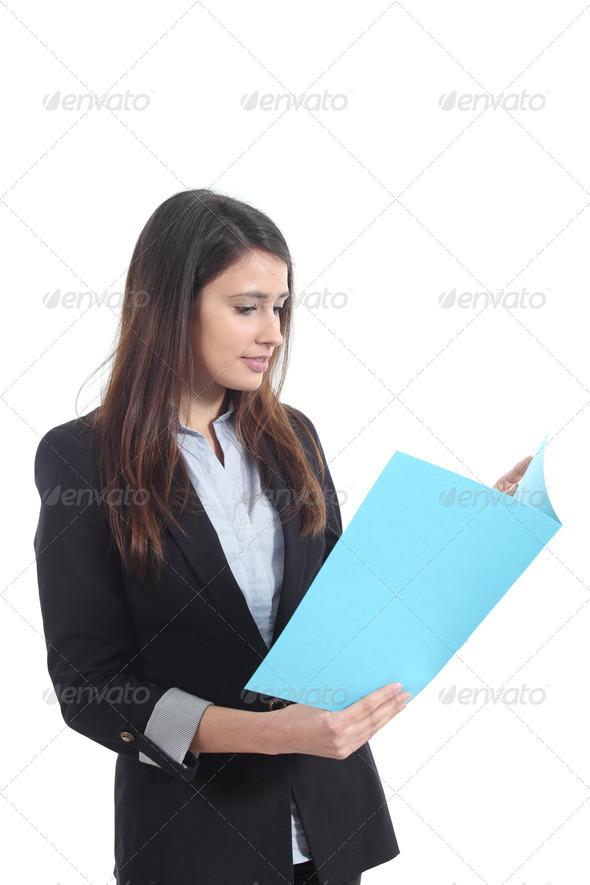 PhotoDune Beautiful businesswoman reading a report 4112141