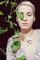 Portrait of a young woman with a passion fruit plant on - PhotoDune Item for Sale
