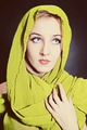 Portrait of  beautiful young woman in bright, green head scarf - PhotoDune Item for Sale
