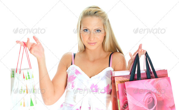 PhotoDune Young pretty woman with shop bags Isolated on white 4125010
