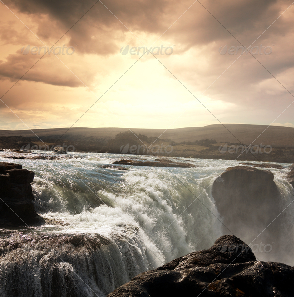 Waterfall in Iceland - Stock Photo - Images