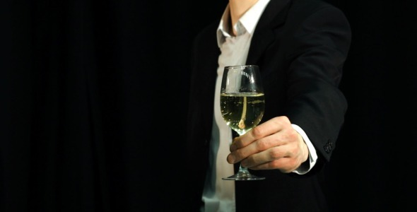 Gentleman Extending Hand With Champagne Glass