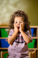 Worried child with mouth open in kindergarten - PhotoDune Item for Sale