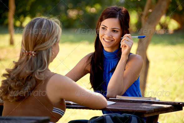Young college students talking and studying for university exam - Stock Photo - Images