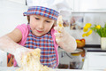 Little girl kneading dough - PhotoDune Item for Sale