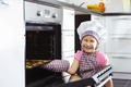 Cute little girl put cookies in stove - PhotoDune Item for Sale