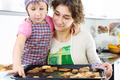 Little girl and mother with baked cookies - PhotoDune Item for Sale