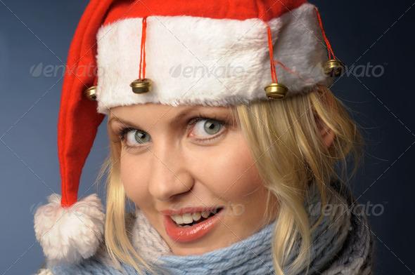 blonde girl in santa hat - Stock Photo - Images