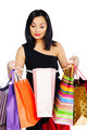 Young brunette woman with shopping bags isolated on white - PhotoDune Item for Sale