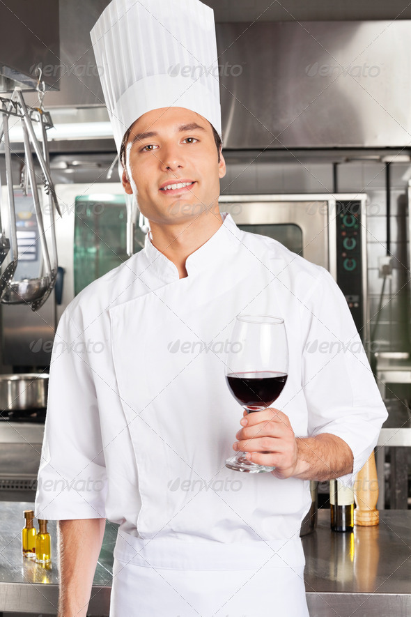 Chef Holding Glass Of Red Wine - Stock Photo - Images