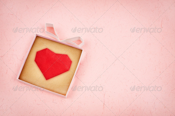PhotoDune Hand made gift box with heart inside textured paper as backgro 4154180