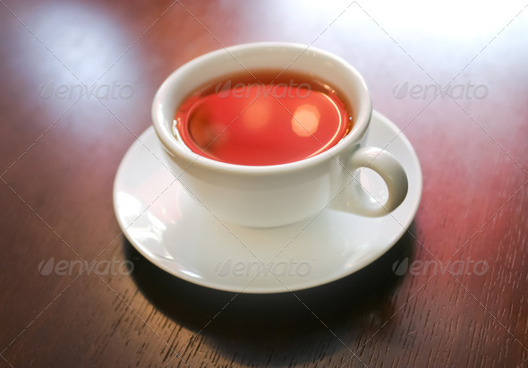 PhotoDune Cup of tea on wooden table macro 4154186