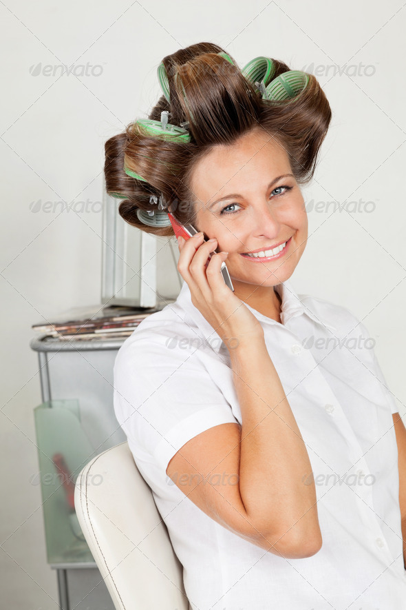 Happy Woman With Hair Curlers On Call - Stock Photo - Images