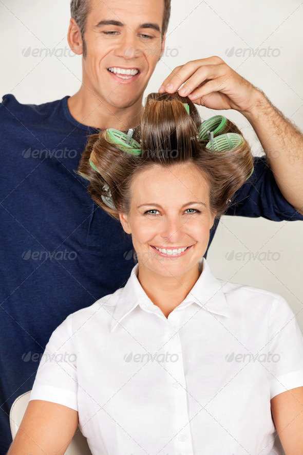 Client With Hairstylist Rolling Her Hair - Stock Photo - Images