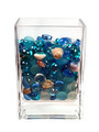 Blue glass pebbles and seashells in the glass - PhotoDune Item for Sale