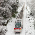 Passenger train moving along snow track - PhotoDune Item for Sale