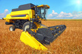 combine harvester on a wheat field with a blue sky - PhotoDune Item for Sale