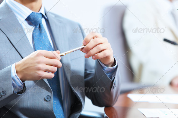 Hands of businessman laying on table - Stock Photo - Images