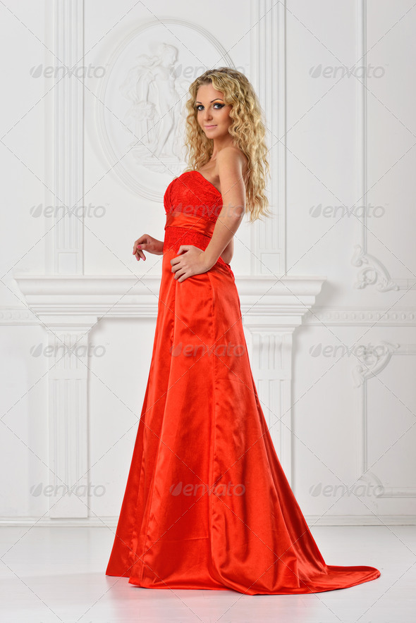 beautiful woman in red long dress. - Stock Photo - Images