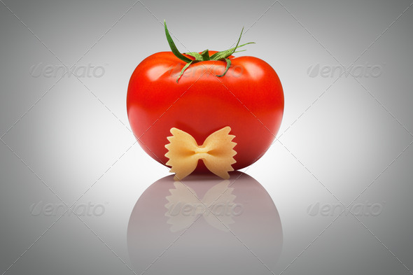 Quite an imposing sir tomato. - Stock Photo - Images