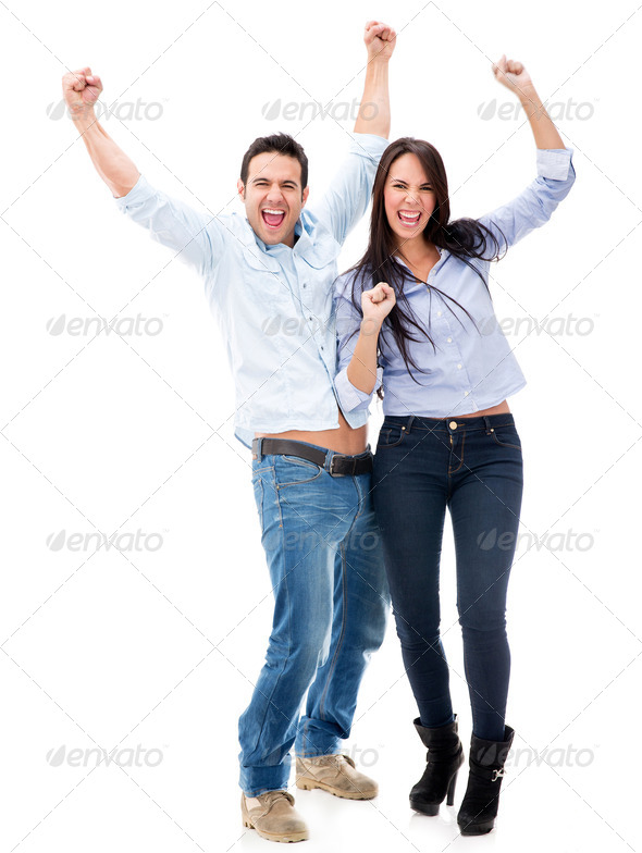Happy couple with arms up - Stock Photo - Images