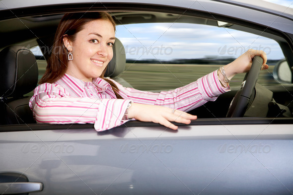 woman driving a car - Stock Photo - Images