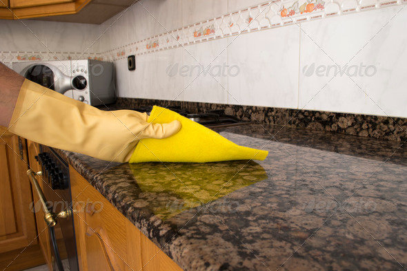 PhotoDune Woman cleaning kitchen with cloth 4203617