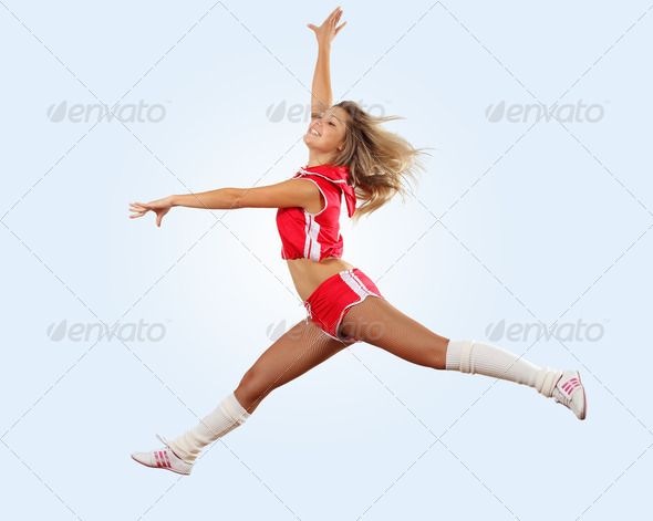 cheerleader girl jumping - Stock Photo - Images